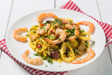 Paella with chicken, shrimp and squid rings