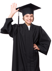 Portrait of graduate little girl student in black graduation gown with hat, close up - isolated on white background. Child back to school and educational concept.