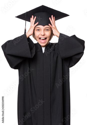 Portrait of graduate little girl student in black graduation gown ...