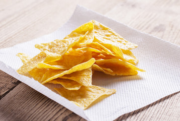 chips on a white paper napkin, on a table