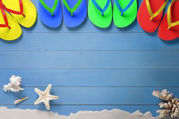 Summer, multicolored flip flops on wooden floor