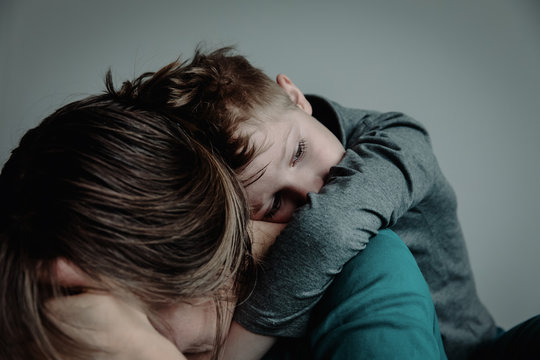 sad child with mother, family in sorrow
