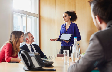 Businesswoman giving presentation during office meeting