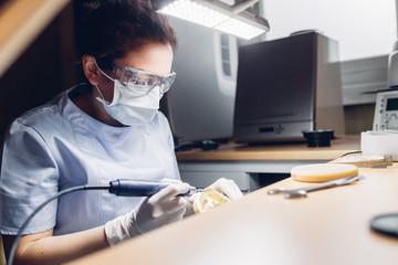 Dentist making denture in laboratory