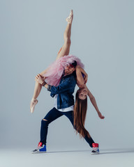 Young beautiful dancers are posing in the studio