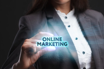 The concept of business, technology, the Internet and the network. A young entrepreneur working on a virtual screen of the future and sees the inscription: Online marketing