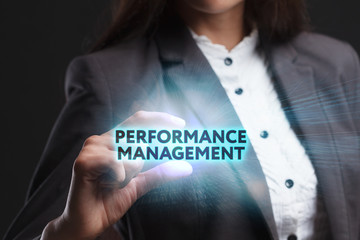 The concept of business, technology, the Internet and the network. A young entrepreneur working on a virtual screen of the future and sees the inscription: Performance management