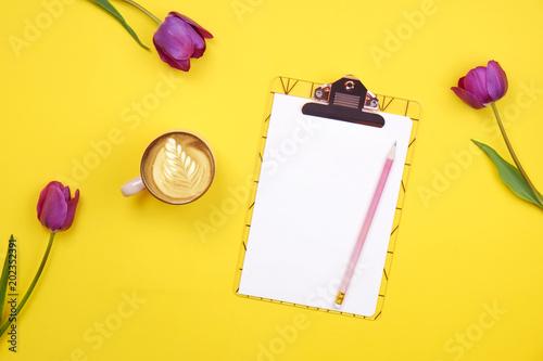 Feminine desktop composition with blank sheet clipboard pencil feminine desktop composition with blank sheet clipboard pencil coffee cup tulips bouquet on voltagebd Choice Image