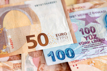 Turkish and European currency - close-up of mixed Lira and Euro banknotes