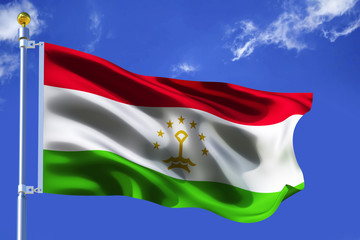 The silk waving flag of Tajikistan with a flagpole on a blue sky background with clouds .3D illustration.