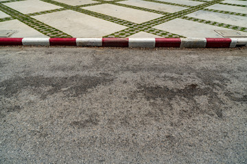Red and white concrete road curb