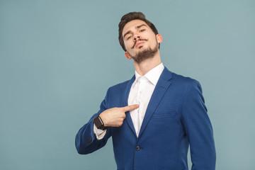 Closeup portrait of proud man pointing finger himself