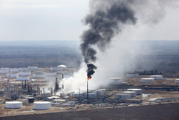 White smoke rises from a rupture in the tank just behind the smokestack following an explosion at Husky Energy oil refinery in Superior