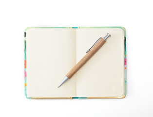 Decorative diary with a wooden pen lying on it