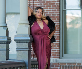 Plus Size Model in a Dress and Fur Vest