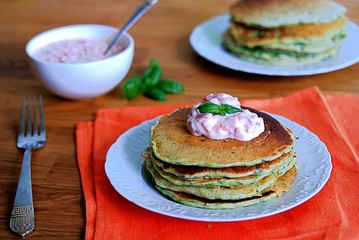 Lush pancakes with spinach. Served with a sauce of Greek yogurt and baked sweet pepper