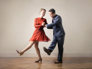 Dancers dancing together, dressing up with vintage clothes