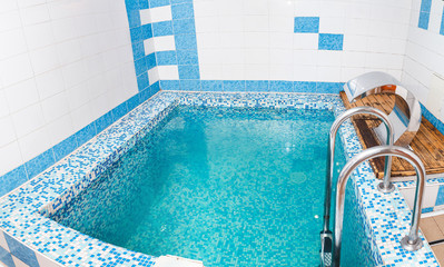 Small swimming pool with blue fresh water at the bath complex, hardening concept
