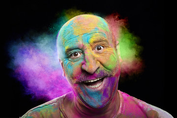 Portrait of bald smiling man with colorful face