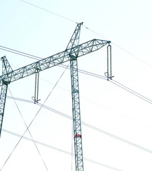 Power transmission system With the sky and the beautiful clouds in bright days. Power poles and power lines. Optical fiber system Internet communication system at the power poles