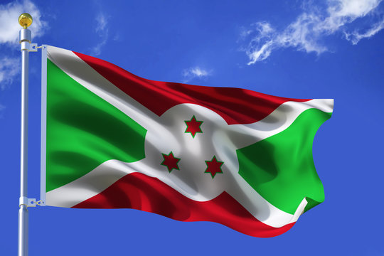 The silk waving flag of Burundi with a flagpole on a blue sky background with clouds .3D illustration.