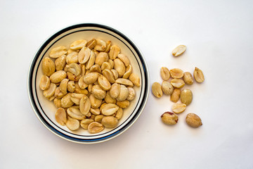 Bowl of Peanuts on a white background
