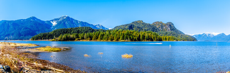 Panorama with a Fishing Boat on Pitt Lake with the Snow Capped Peaks of the Golden Ears, Tingle Peak and other Mountain Peaks of the Coast Mountains of British Columbia, Canada Fototapete