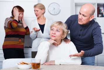 Mature man is warm apologizing to woman after quarrel