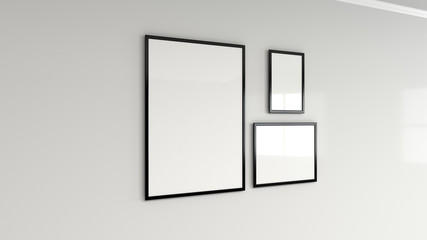Blank white poster in black frame on the wall