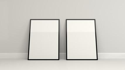 Blank white poster in black frame standing on the floor