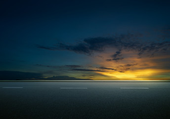 Asphalt road with dramatic sunrise sky , Horizontal format .
