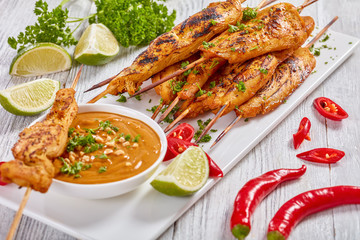 Chicken satay on skewers with sauce