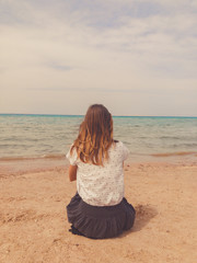 Single woman looking at ocean / sea view.