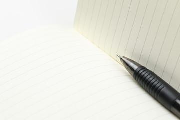 pen and blank opened notebook