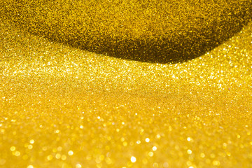 Abstract shiny gold glitter texture background, festive season concept background