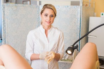 A gynecologist wears gloves. Gynecological office. Gynecologist inspects