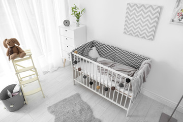 Baby room interior with comfortable crib