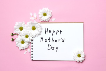 """beautiful composition of flowers to the day of the mother. postcard """"happy mother's day"""" on a pastel background with flowers. congratulation. minimalism, top view. flat lay"""
