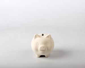 White piggy bank on grey background