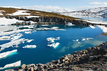 Photo sur Plexiglas Glaciers Norway. Icebergs and lakes, formed as a result of melting of the Svartesen glacier