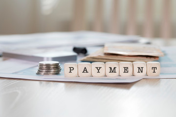 Word PAYMENT composed of wooden letters.
