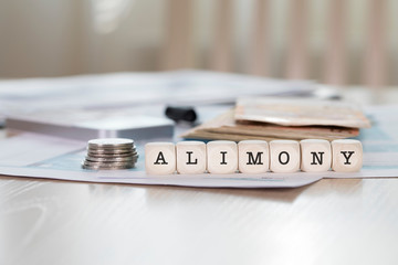 Word ALIMONY composed of wooden letters.