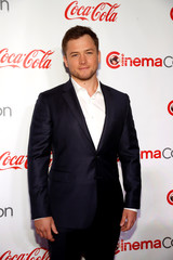 Taron Egerton, recipient of the Action Star of the Year award, poses during the CinemaCon Big Screen Achievement Awards in Las Vegas