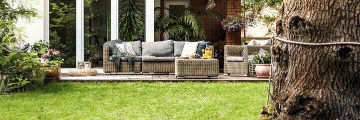 Wicker sofa by the house