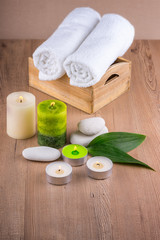 Spa decoration with candles, towels and spa stones