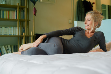 Mature woman relaxing on bed