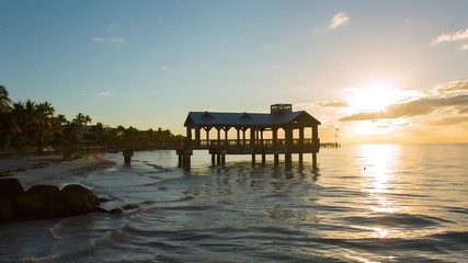 Fototapete - Pier at the beach on sunrise in Key West, Florida USA. Raw video source.