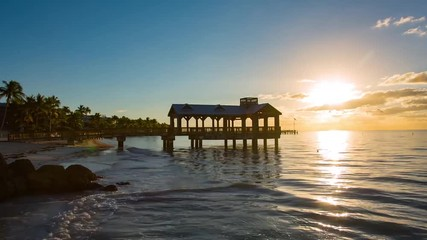 Fototapete - Pier at the beach on sunrise in Key West, Florida USA. Timelapse.