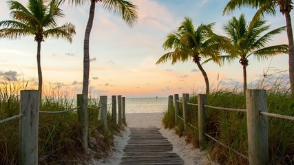 Fototapete - Footbridge to the Smathers beach on sunrise - Key West, Florida. Raw video source.
