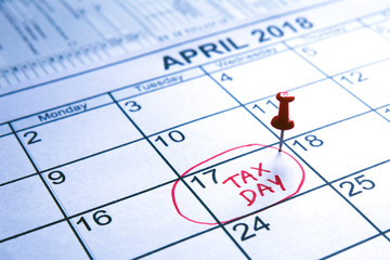 "Pin on the date.April monthly calendar with the 17th circled with the words ""Tax Day"" written in the circle in red colour"